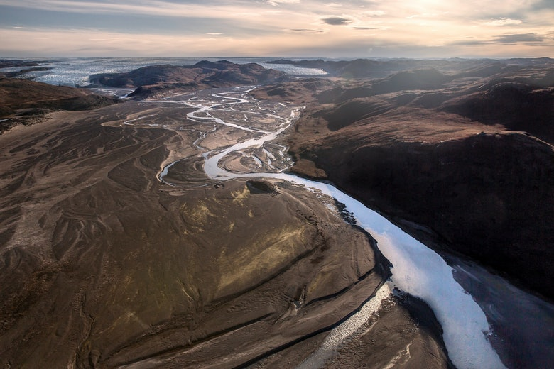 A meltwater river in Kangerlussuaq seen from an Air Zafari flight in Greenland Mads Pihl and Air Zafari and Visit Greenland