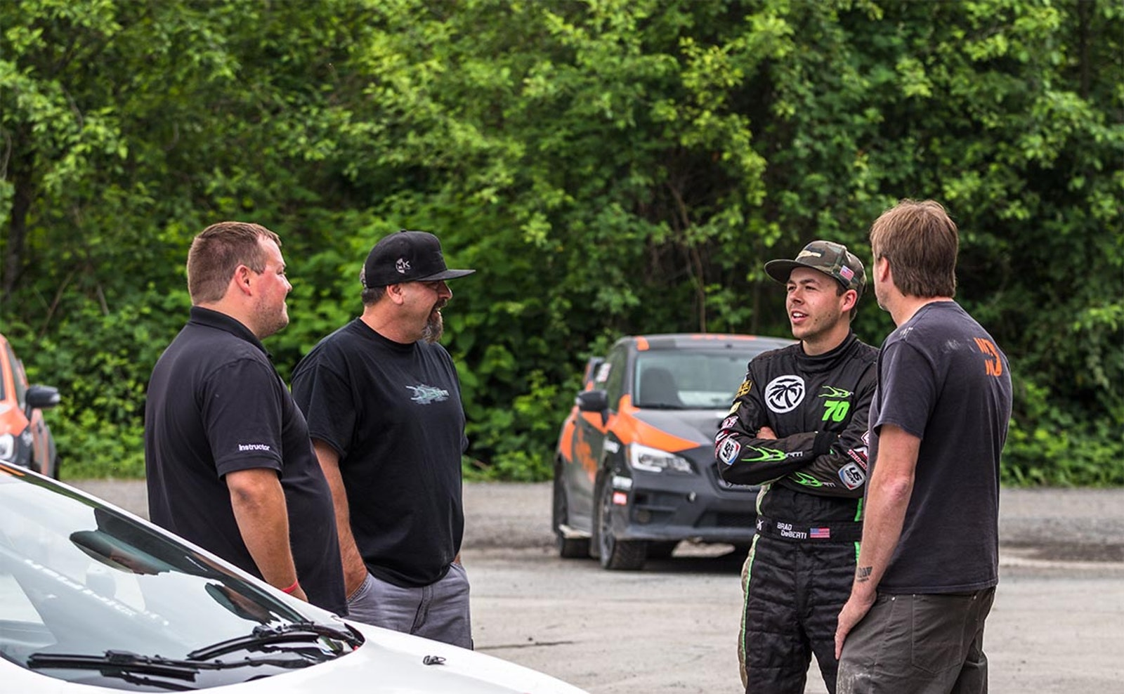 Brad DeBerti and Doug DeBerti talking with motorsports team at DirtFish